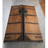 A pair of large antique metal bound oak doors. H.196 x 59cm