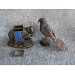 An antique silver plate and blue enamel elephant match holder with gilded details and an Indian