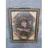 An early Victorian framed wax flower marriage wreath, circa 1893. Carved gilt frame and mirror panel