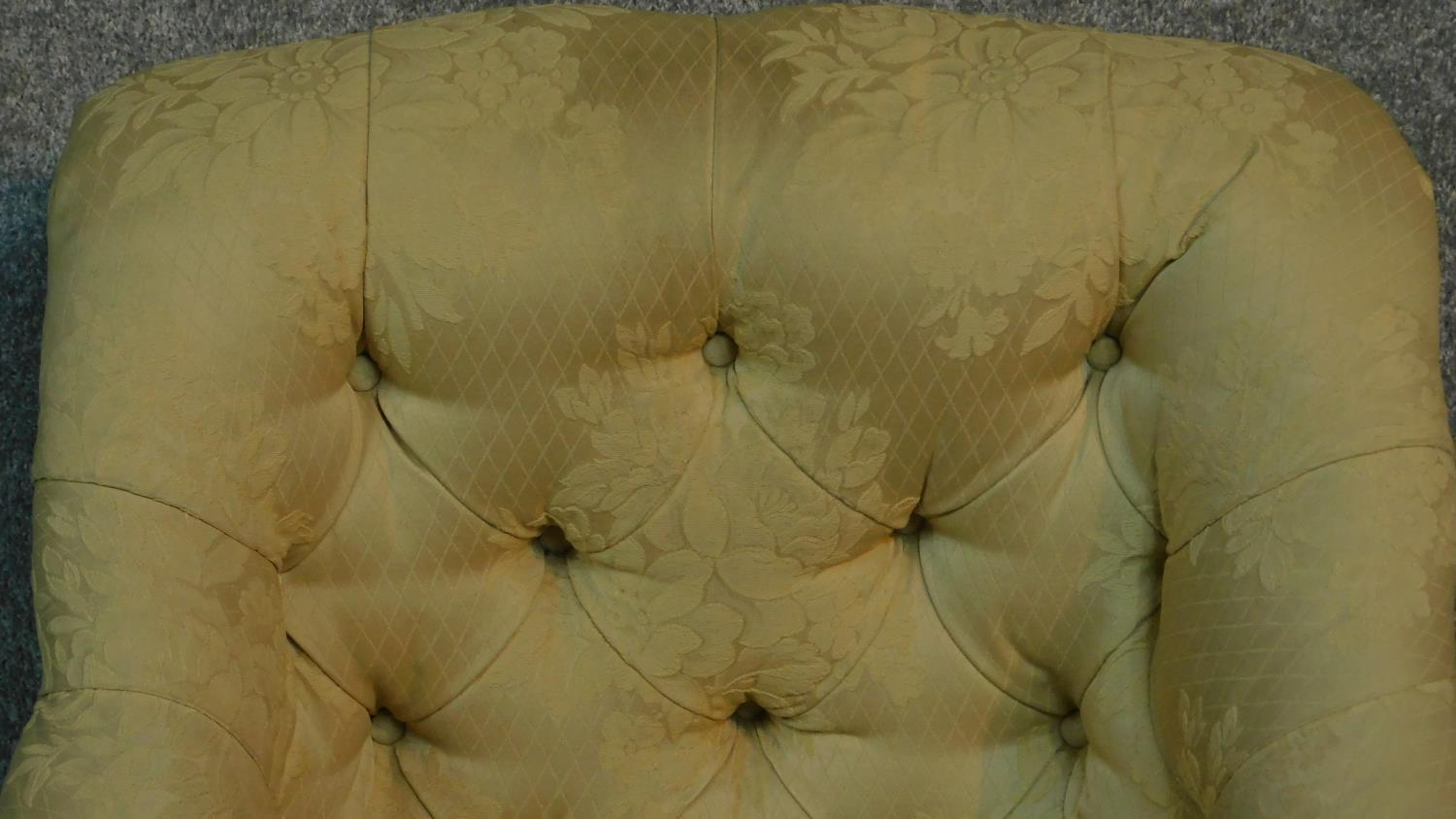 Lot 9 - A Victorian armchair with cream and floral upholstery, raised on turned tapering supports. H.87cm