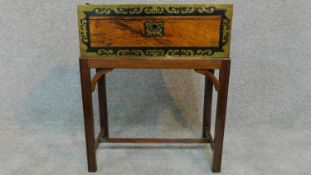 A Victorian walnut writing box with ebony and brass decoration and gilded tooled red leather