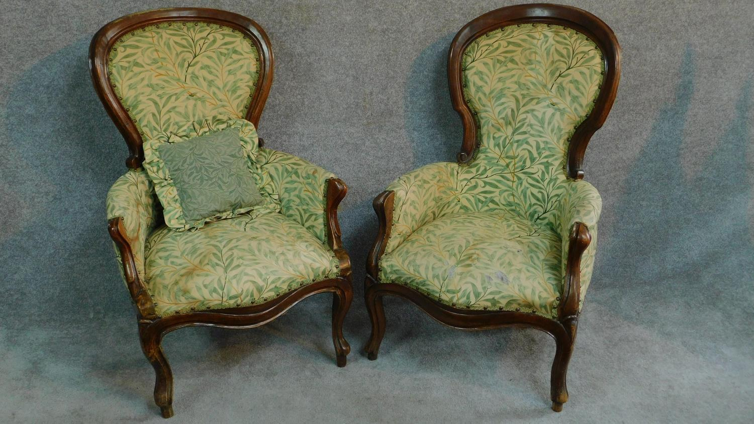 Lot 7 - A near pair of French style walnut framed spoon back armchairs on cabriole supports. H.101cm