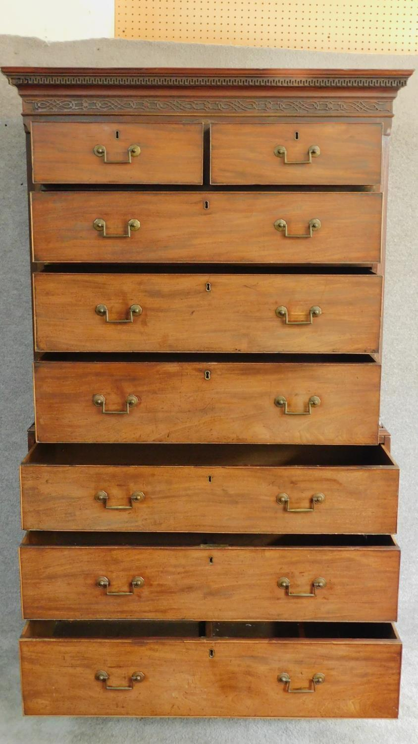 Lot 16 - A Georgian mahogany two part chest on chest of two short over six long drawers fitted with
