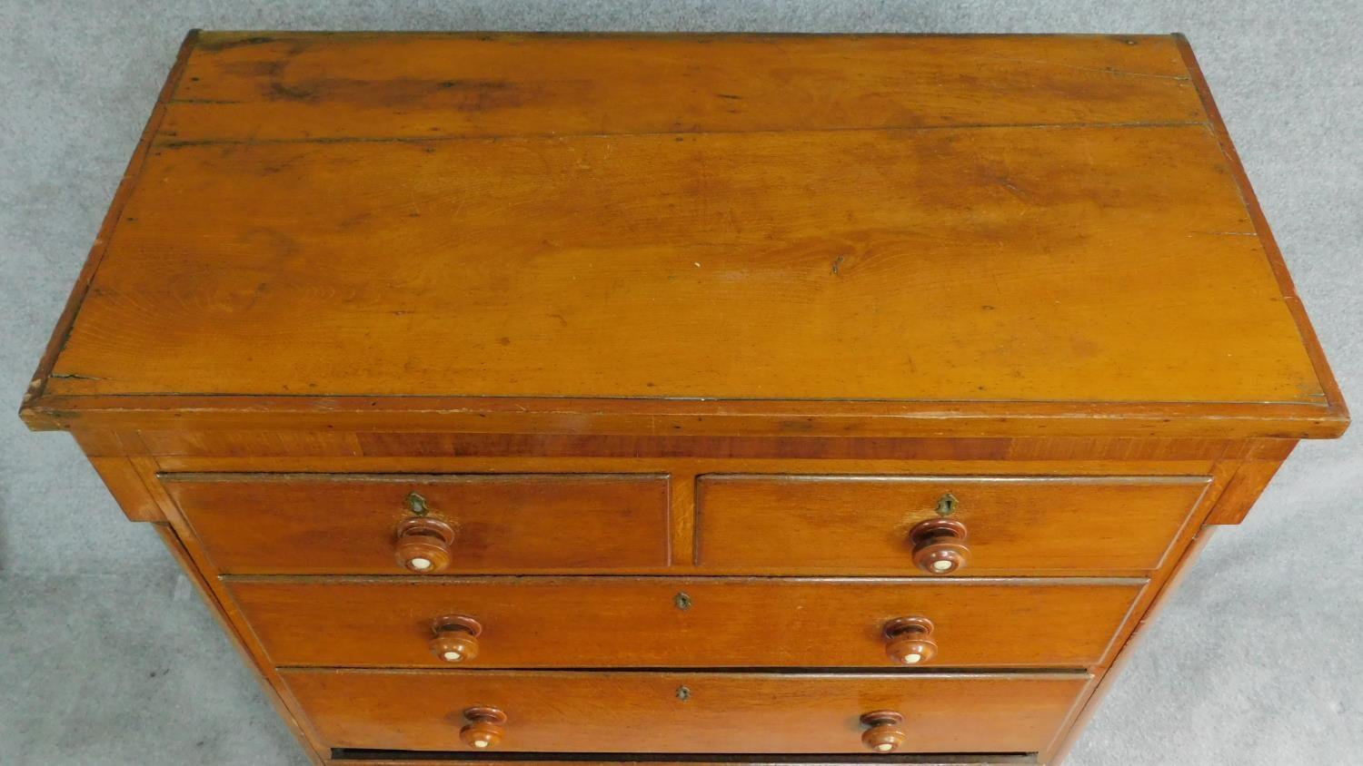 Lot 19 - A Victorian oak and mahogany chest of two short over three long drawers flanked by pilasters