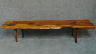 A Vintage natural form yew wood coffee table by Reynolds of Ludlow. H.40 W.104 D.43cm