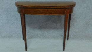 A Georgian mahogany tea table raised on tapering square legs. H.73 W.92 D.90cm