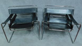 A pair of Vintage Wassily B3 style black leather armchairs on chrome support. H.72cm
