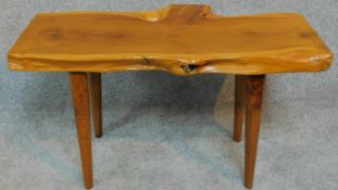 A vintage natural form yew wood bench by Reynolds of Ludlow. H.40 W.74 D.37cm