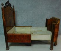 A 19th century French burr walnut nursing bed with floral carvings to the top and to the legs,