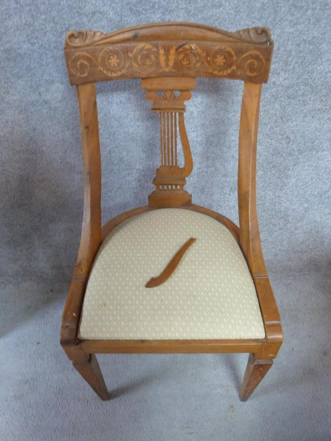 Lot 2 - A set of four 19th century Continental walnut and satinwood inlaid chairs, lyre shaped backs on