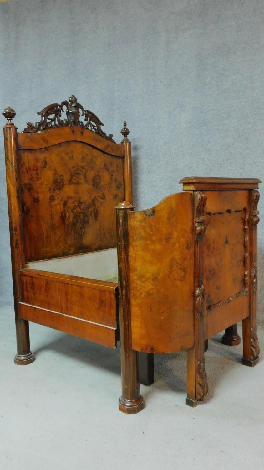 Lot 3 - A 19th century French burr walnut nursing bed with floral carvings to the top and to the legs,