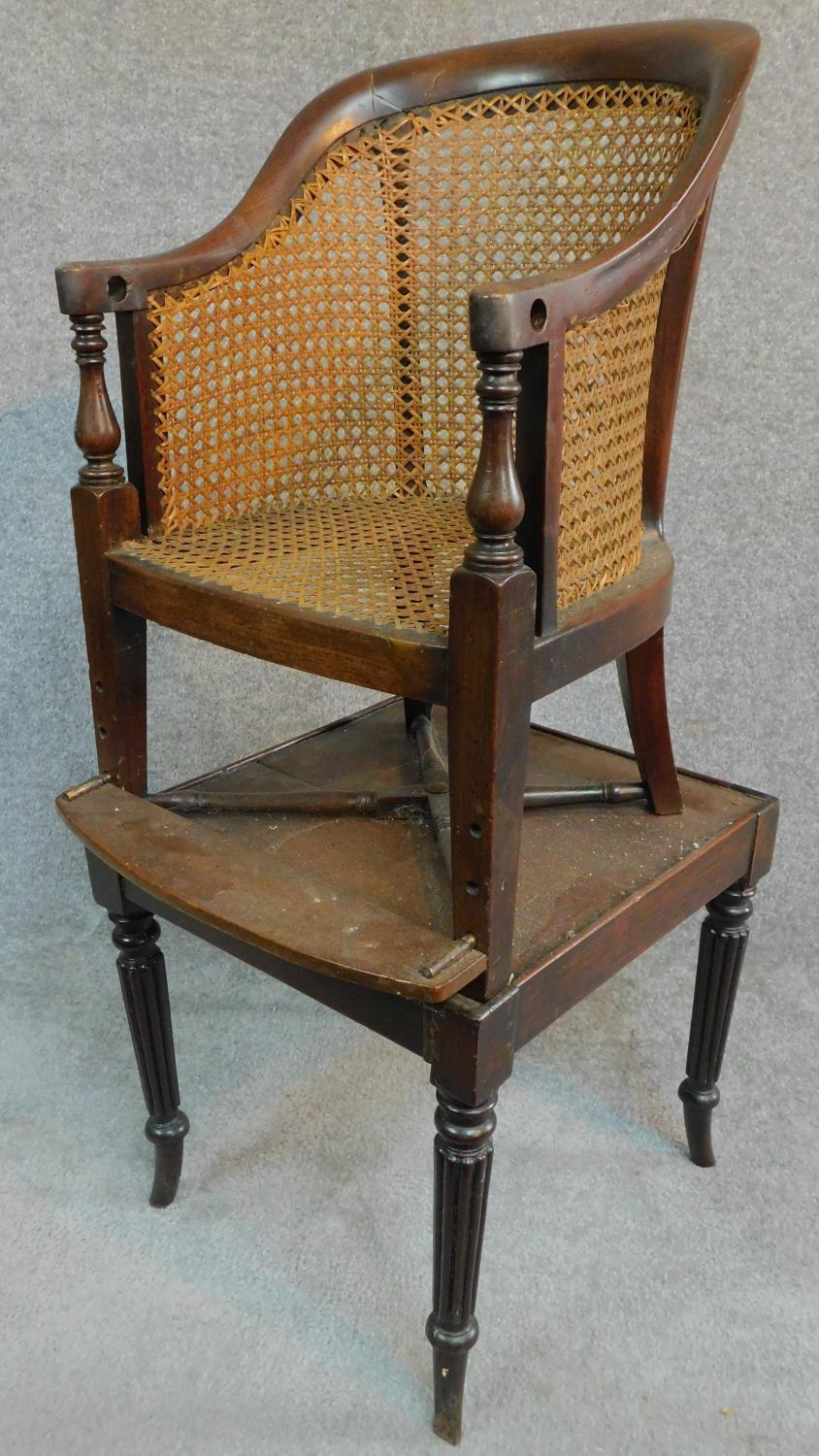 Lot 6 - A Georgian mahogany child's bergere armchair on base with reeded swept supports. H.91cm
