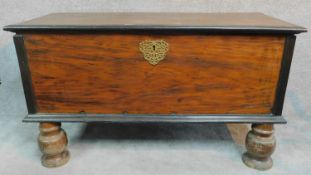 A 19th century Continental cassone with fret cut brass escutcheon, hinged candle box on bulbous