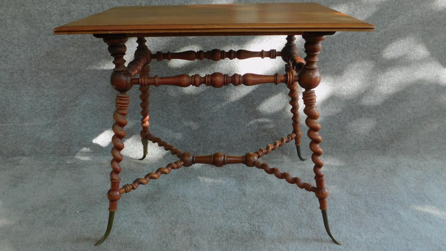 Lot 18 - A Victorian walnut occasional table on turned and spiral twist stretchered base on swept brass