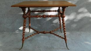 A Victorian walnut occasional table on turned and spiral twist stretchered base on swept brass