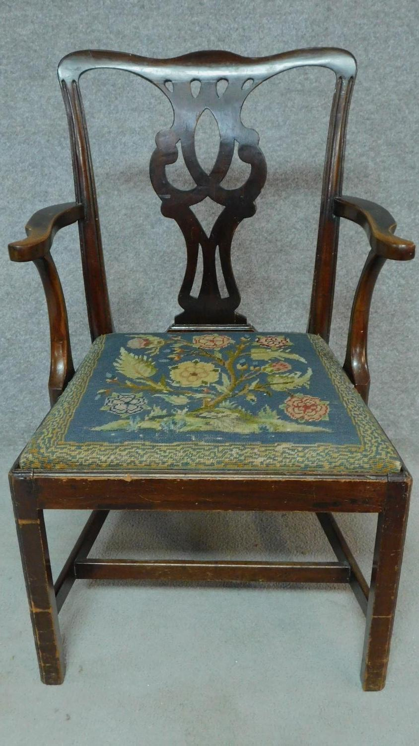 Lot 12 - A Georgian mahogany open armchair with drop in tapestry seat on square tapering supports. H.94cm