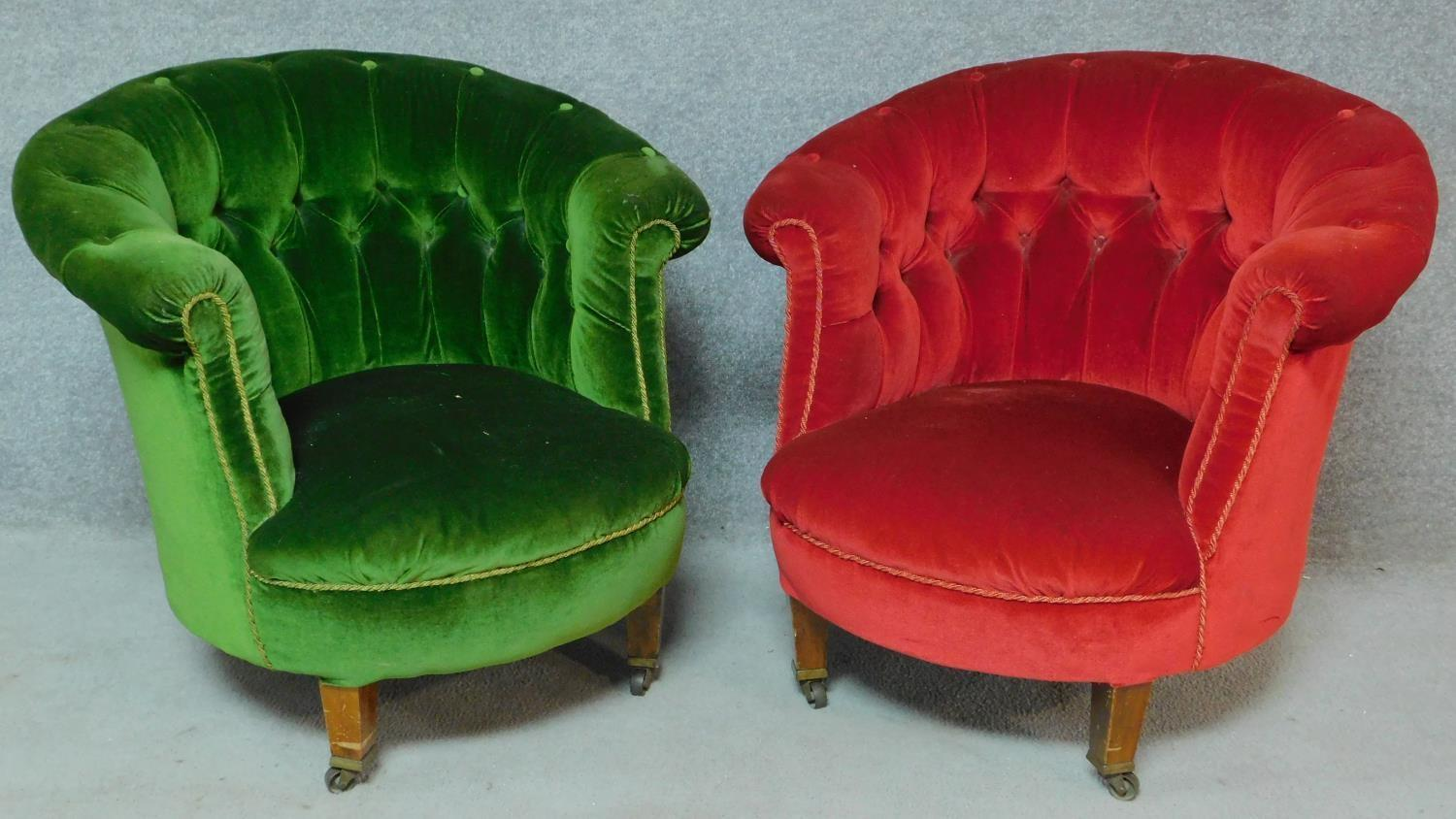 Lot 11 - A pair of Victorian mahogany framed buttoned back tub armchairs on turned tapering supports. H.72cm