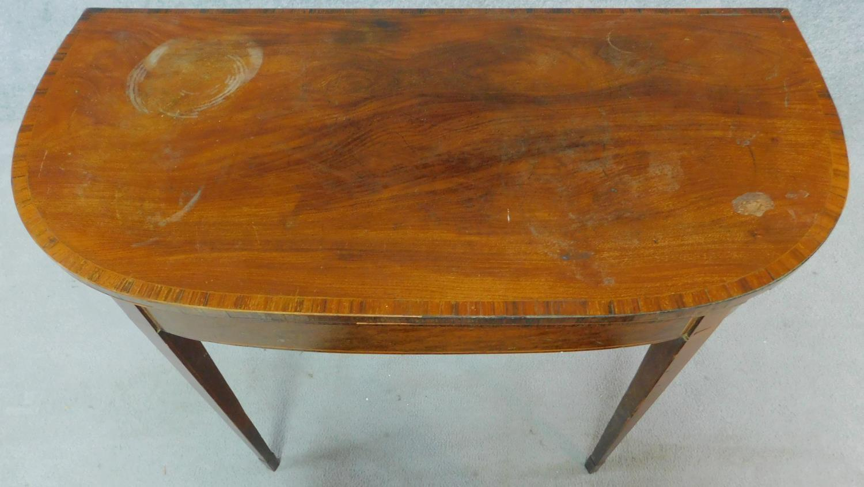 Lot 13 - A Georgian mahogany tea table raised on tapering square legs. H.73 W.92 D.90cm