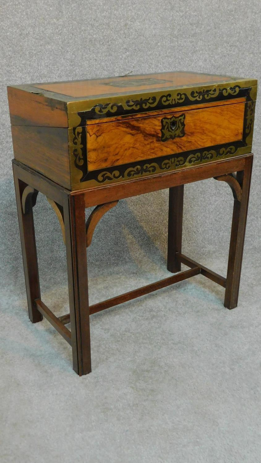 Lot 24 - A Victorian walnut writing box with ebony and brass decoration and gilded tooled red leather