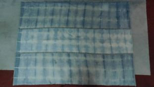 A sedir blue and white tie dye effect rug, some wear in places. 235x172cm