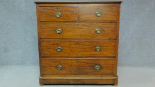 An Edwardian mahogany chest of two short over three long drawers raised on pebble feet. H.123 W.
