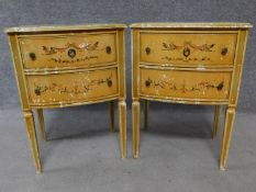 A pair of Italian hand painted bedside cabinets raised on tapering square supports. H.68 W.49 D.39cm