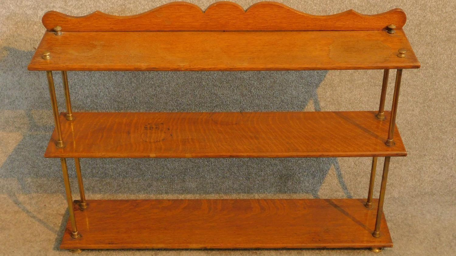 Lot 23 - A set of Victorian oak open shelves with brass supports and feet. H.63 W.89 D.20cm