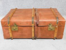 A vintage leather and wood steamer trunk. H.34 W.84 D.54cm