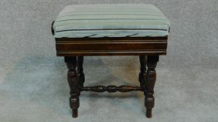 An Edwardian mahogany adjustable piano stool raised on stretchered turned tapering supports. H.46