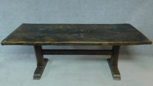 An antique country oak refectory dining table on stretchered platform support. H.76 W.213 D.82cm