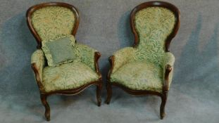 A near pair of French style walnut framed spoon back armchairs on cabriole supports. H.101cm