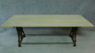 An early 20th Century pine dining table with industrial style metal base. H.65 W.200 D.70cm