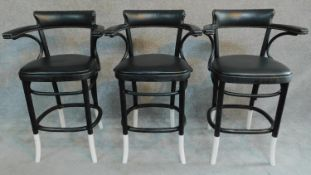 A set of three ebonised bentwood style bar chairs. H.98cm