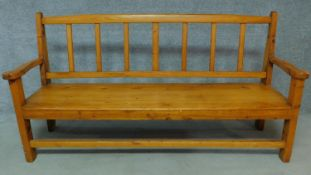 An American yellow wood bench. H.97 W.190 D.55cm
