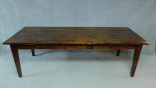 A early 20th Century teak refectory dining table raised on square tapering supports. H.78 W.250 D.