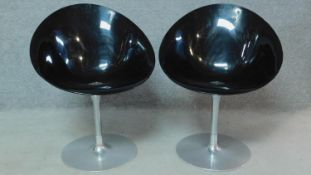 A pair of Vintage black chairs on chrome frame, by Ero (S) Kartell. H.83cm