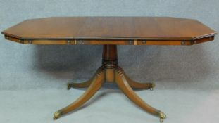 A Regency style mahogany dining table raised on fluted swept quadruped supports. H.79 W.169 D.84cm