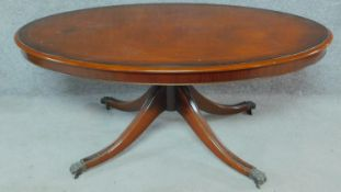 A Regency style mahogany low table raised on turned swept legs on casters. H.54 W.125 D.72cm