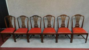 A set of six Georgian mahogany Hepplewhite style dining chairs. H.98cm