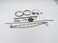 A collection of antique silver and white metal jewellery. Including bangles, an identity bracelet,