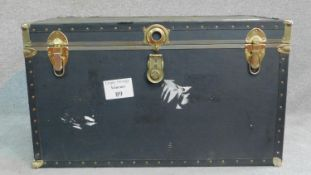 A large contemporary black brass bound steamer trunk. H.55 W.91 D.51cm