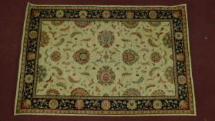A Kashan style rug, all over spandrel motifs with repeating petal motifs on an ivory field,