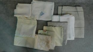 A collection of twelve linen and lace table cloths of different sizes and designs. 290x131cm (