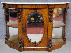 A 19th century marble topped and mirrored burr walnut credenza with floral carvings on shaped plinth