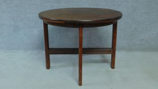 A 20th Century Danish rosewood extending dining table with two extra leaves raised on stretchered