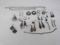 A collection of silver and white metal earrings and other jewellery. Including various gem set