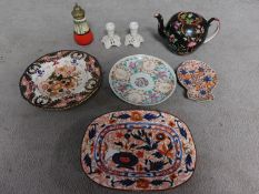 A collection of antique ceramic items. Including a Chinese porcelain plate with character mark to