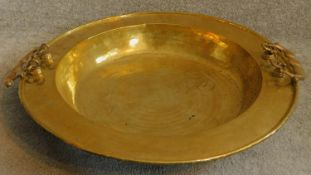 A large Oriental vintage beaten brass bowl with pair of swing handles. 65x65cm