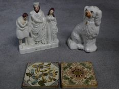 A collection of ceramics. Including a Staffordshire porcelain dog, two antique hand painted tiles