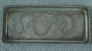 A Chinese Wang Hing 90 Standard silver card tray, rectangular raised on four stepped feet, the